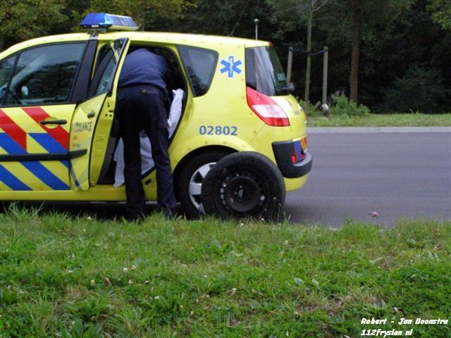 Ambulance met lekke band