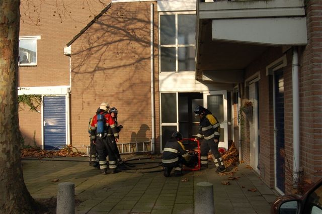 Kranten in brand in trappenhuis