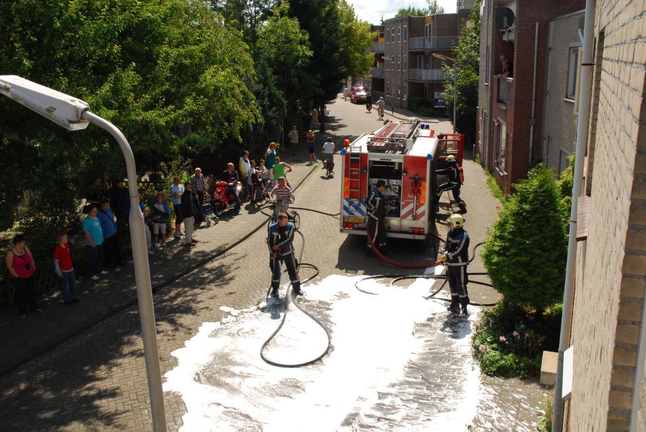 Wasmachine vat vlam