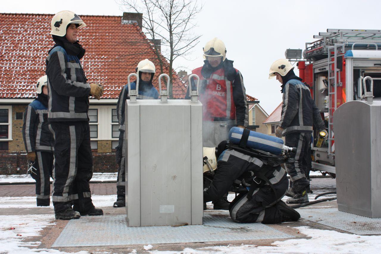 Ondergrondse container in brand