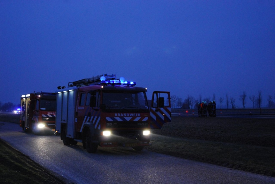 Achterkant auto in brand A31