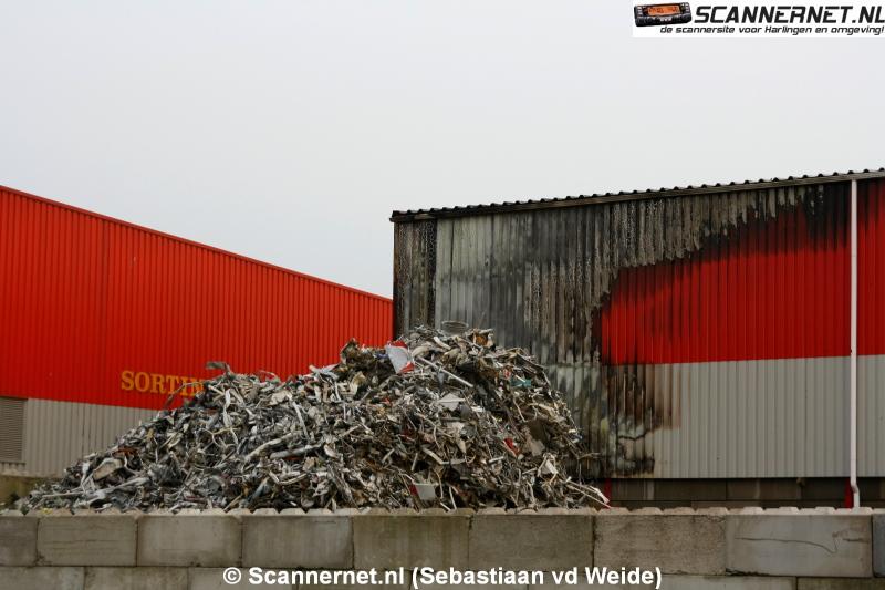 Brand in loods met plastic