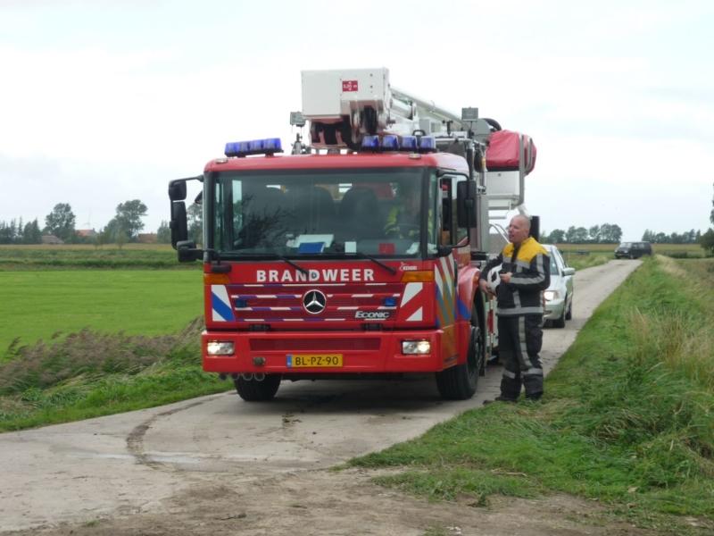 Brandweer blust brand in silo