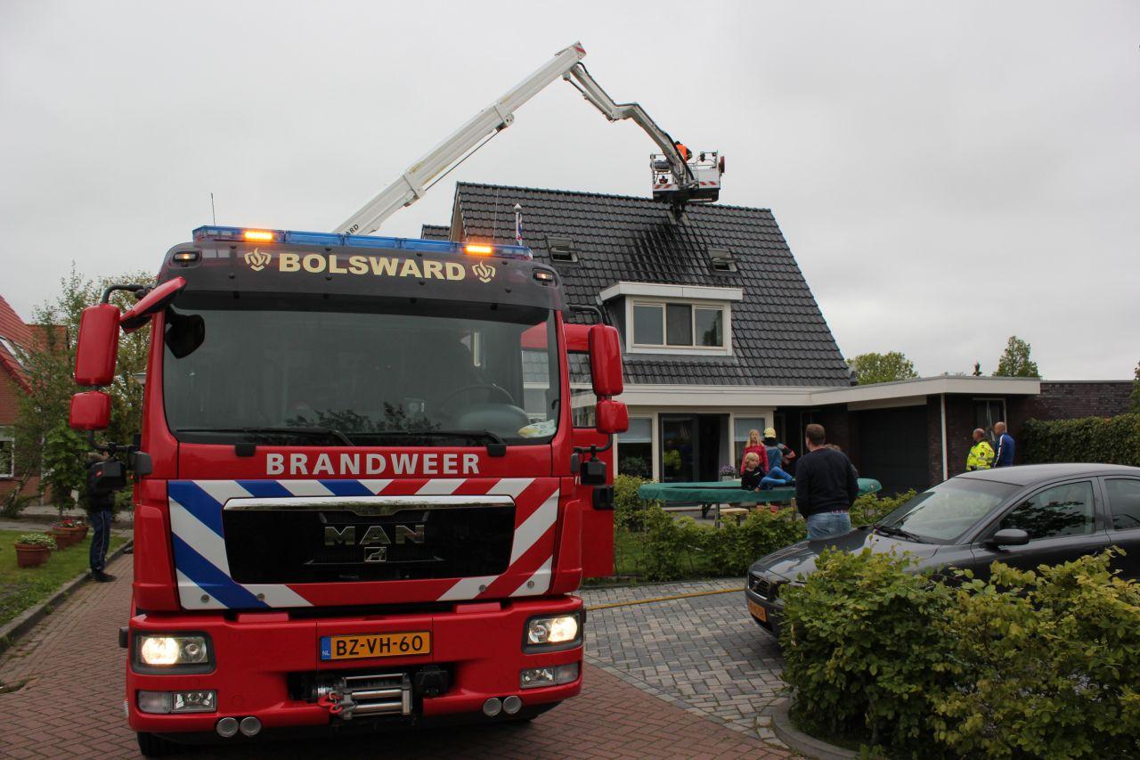 Schoorsteenbrand geblust door naburig brandweerkorps