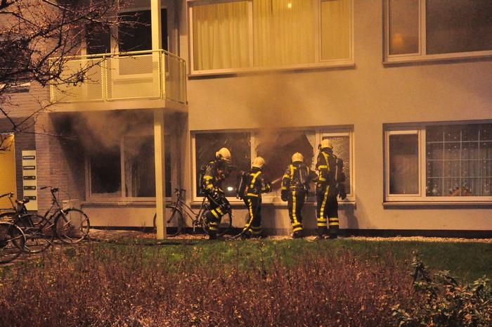 Zeven flatwoningen ontruimd door brand