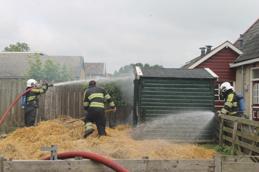 Brand in schuurtje met stro