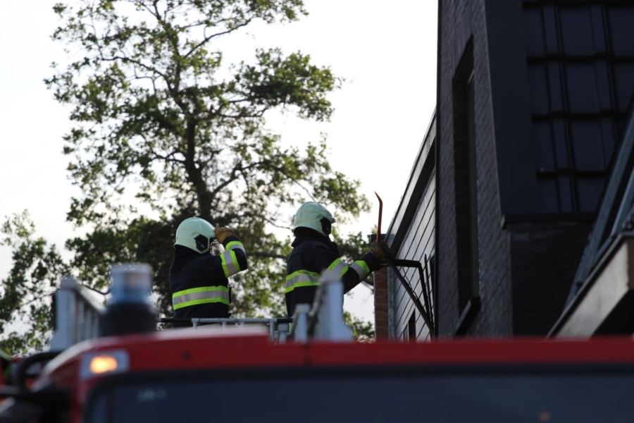 Forse brand in woning boven pizzeria