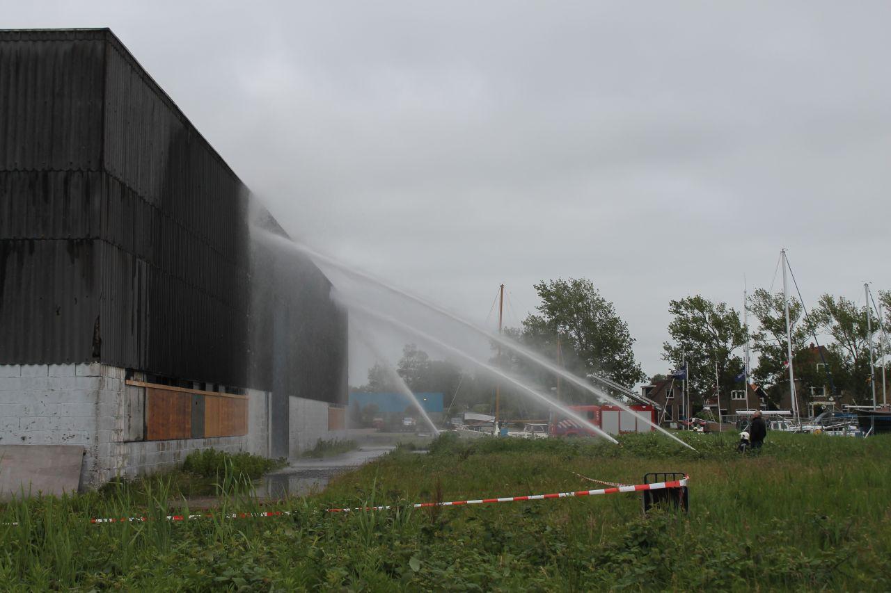 Asbest vrijgekomen bij grote brand in loods