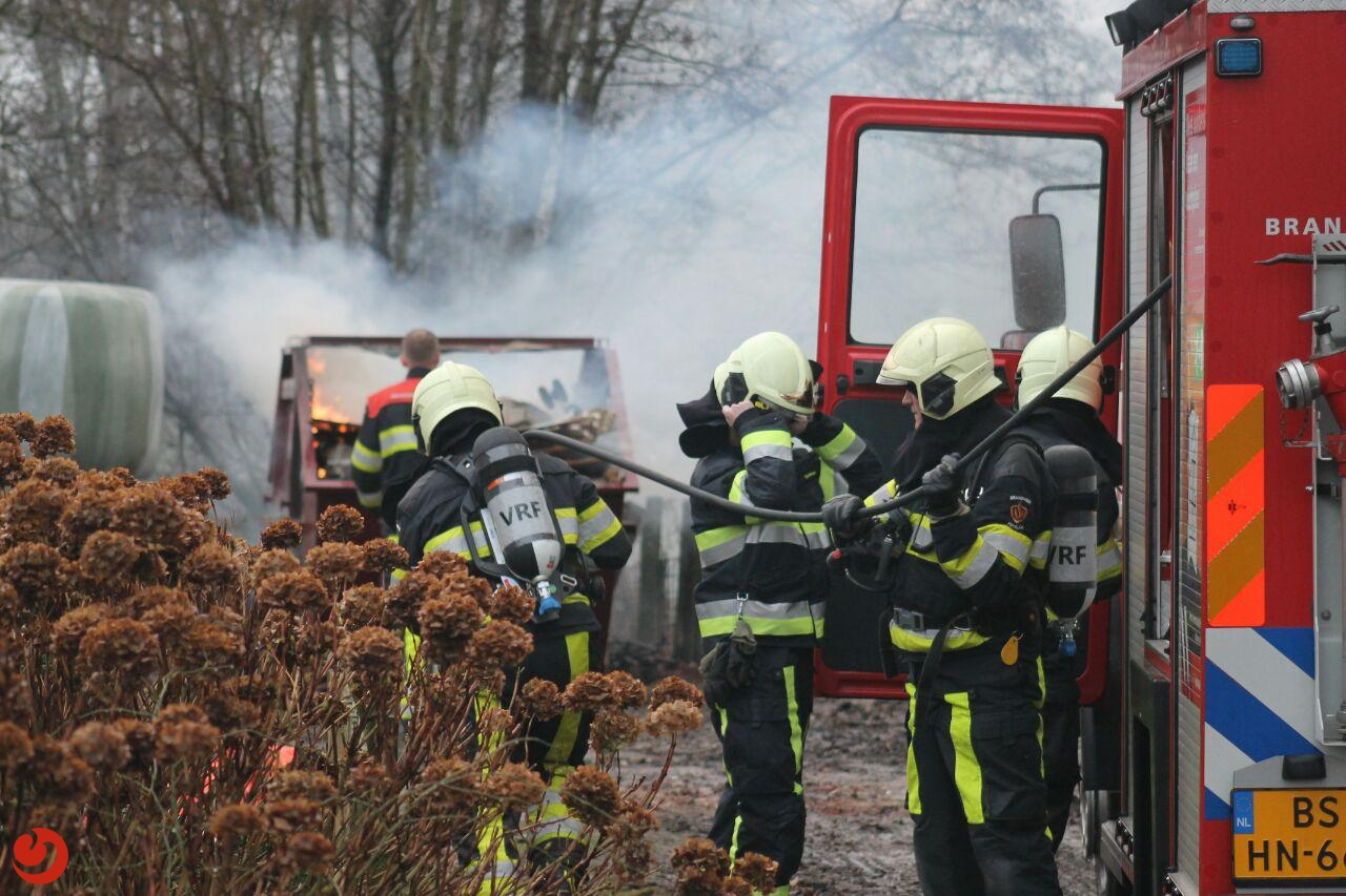 Brand in container met grofvuil