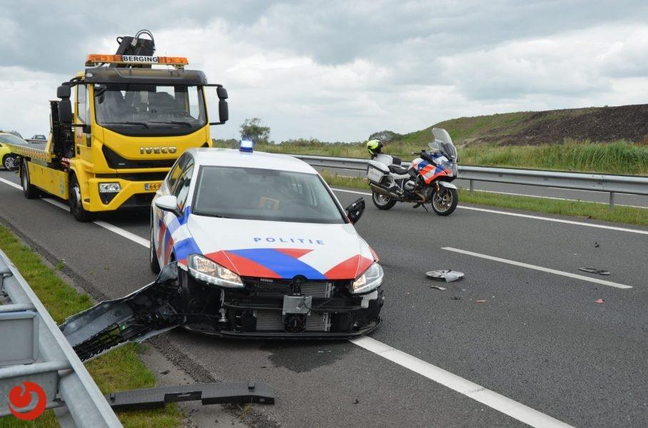 Politieauto aangereden tijdens beveiligen pechgeval N31