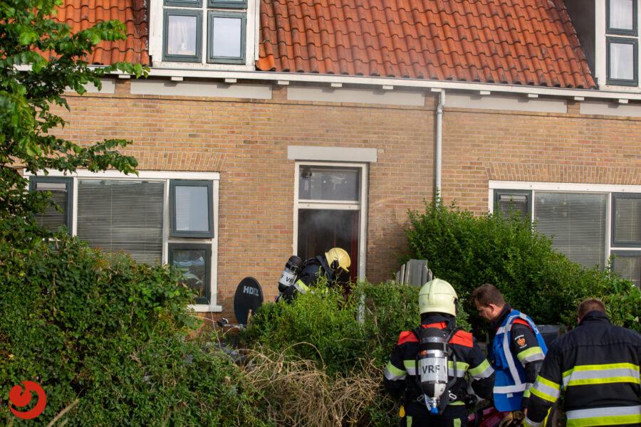 Veel rook bij woningbrand
