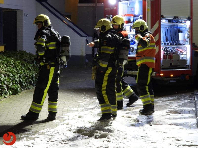 Brandweer blust keukenbrand