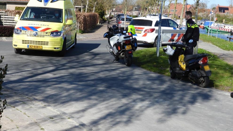 Racefietser gewond na botsing met scooter